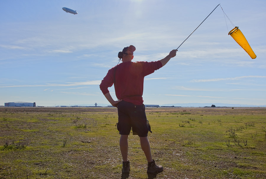 Groundstaff guides airship to landing site