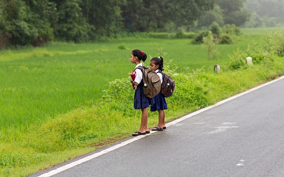 Waiting for the school bus, in Galgibaga, Canacona