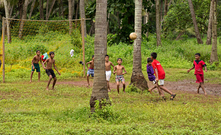 Football in coconut orchard in Gauxim