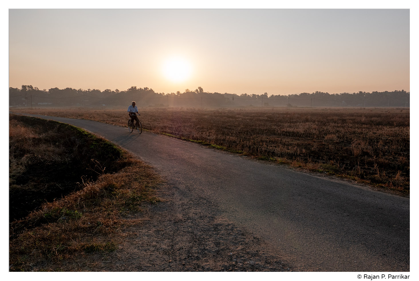 Cycling to New Year's morning mass, St. Estevem, Goa