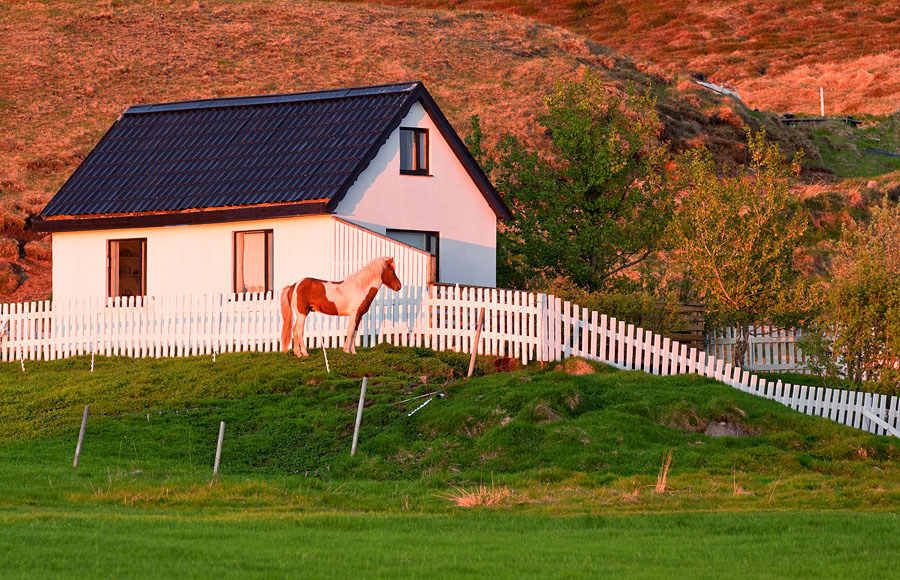 Farmhouse on Skagafjörður awash in the midnight sun