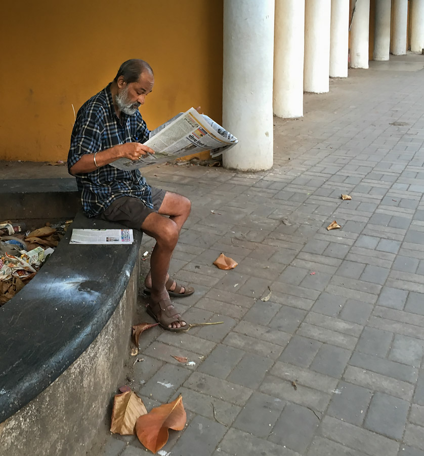 Reading newspaper in Panjim, Goa