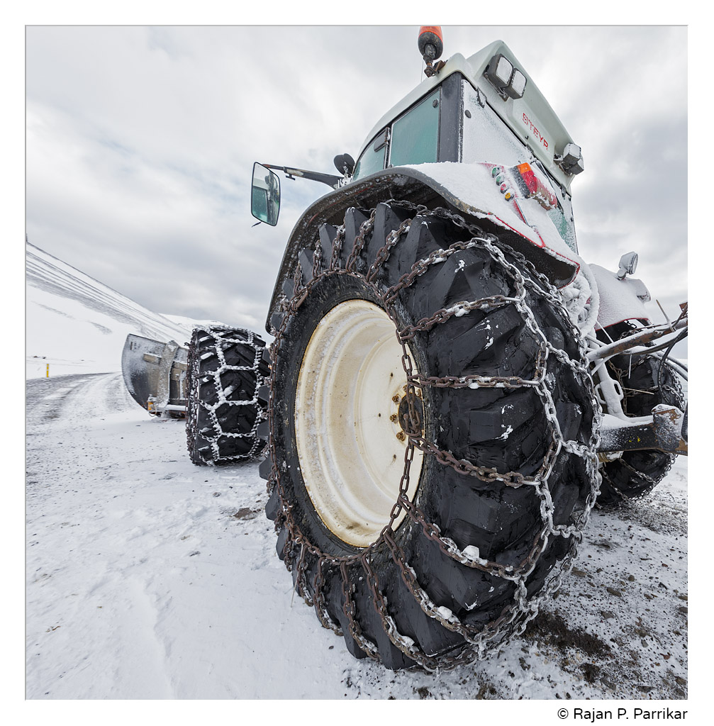 Tractor with snow plow in Melavík, Strandir, Iceland