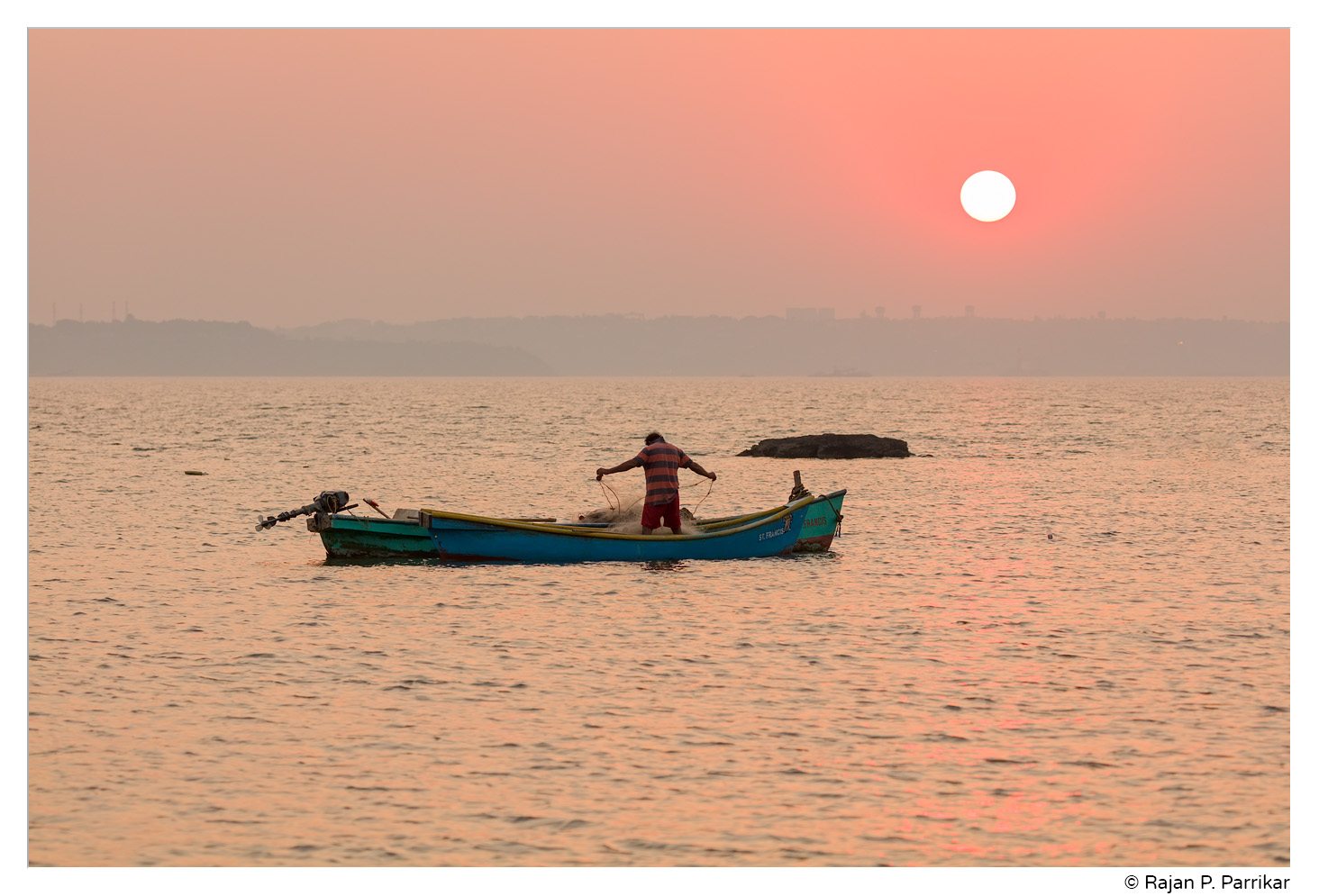 Lone fisherman and last sunset of 2018, Siridona, Goa
