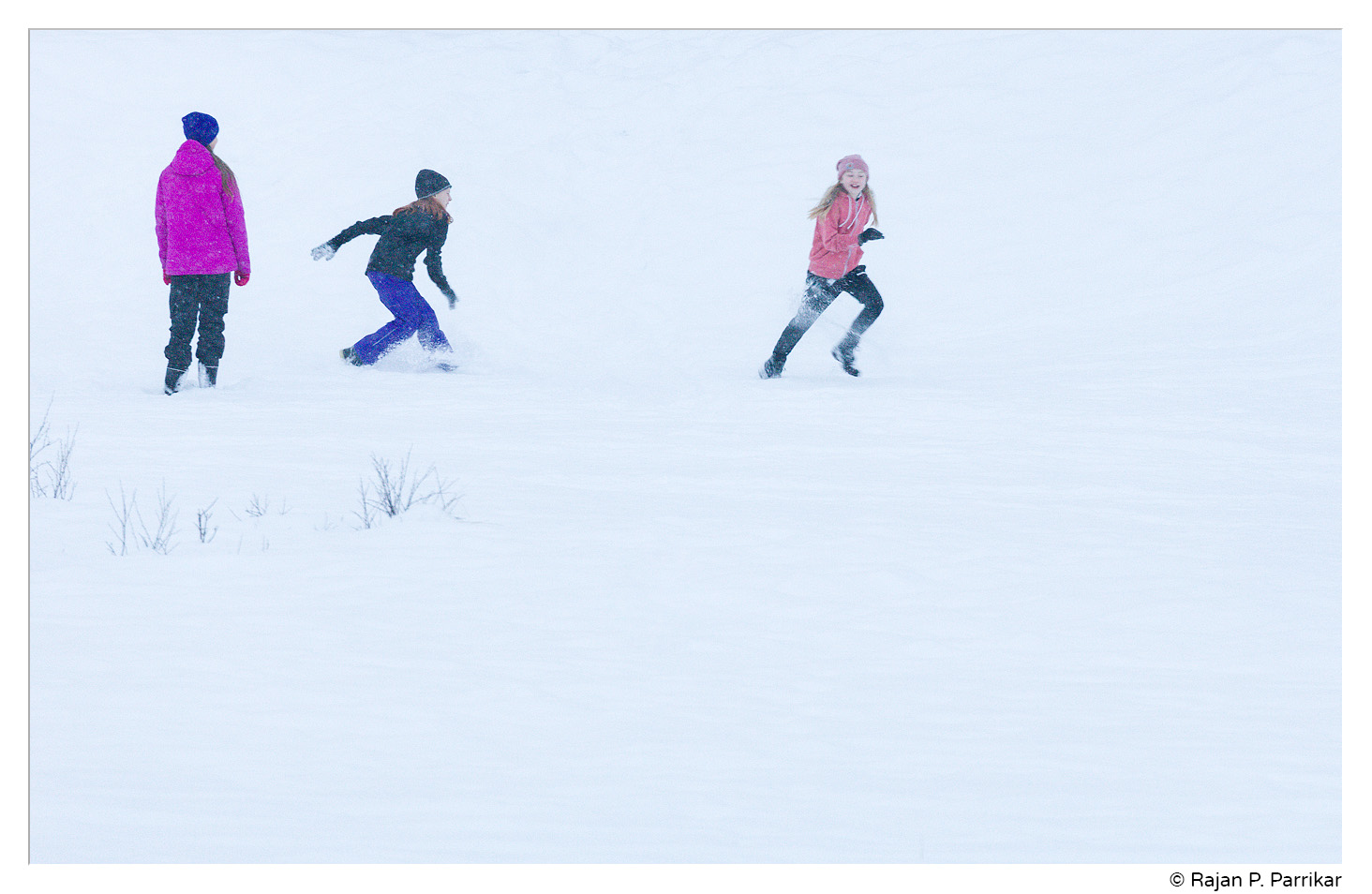 Playing in the snow, Reykjavík, Iceland
